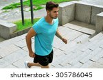 young man jogging at stairs... | Shutterstock . vector #305786045