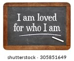 Small photo of I am loved for who I am - positive affirmation words on a vintage slate blackboard