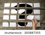 Small photo of Question or query - solution or answer concept with a woman laying out rows of memo notes with a question mark and placing the last piece in place on the wooden background, close up of her hand.