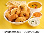 vada is donut  made with urad... | Shutterstock . vector #305907689