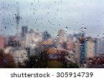 urban view of rain drops falls... | Shutterstock . vector #305914739