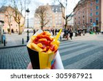 holding typical belgian fries... | Shutterstock . vector #305987921