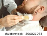 handsome man getting his beard... | Shutterstock . vector #306021095