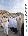 Small photo of MECCA, SAUDI ARABIA - JUNE 2: Muslims at Mount Arafat (or Jabal Rahmah) June 2, 2015 in Arafat, Saudi Arabia. This is the place where Adam and Eve met after being overthrown from heaven.