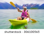 young asia man paddling in... | Shutterstock . vector #306100565