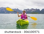 young asia man paddling in... | Shutterstock . vector #306100571