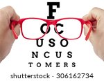 red spectacles focusing on text ... | Shutterstock . vector #306162734