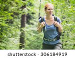 an active young woman hiking in ... | Shutterstock . vector #306184919