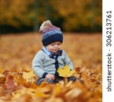 Cute Little Baby In Autumn Par...