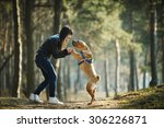 young girl with dog in the park | Shutterstock . vector #306226871