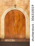 front doors arched detail... | Shutterstock . vector #306310019