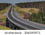 Saint Petersburg, Russia - August 7, 2015: Top view of highway bridge in final stage of construction, and a high-speed road in the forest. Leningrad Region, new motorway in  direction of Sortavala. - stock photo