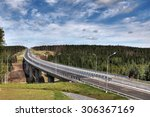 Saint Petersburg, Russia - August 7, 2015: Forest road and unfinished bridge in the Leningrad region, Priozersk District. - stock photo