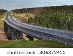 Saint Petersburg, Russia - August 7, 2015: Four-speed road through the forest, and a steel motor road bridge on reinforced concrete piers, Priozersk district, Leningrad region, highway Sortavala. - stock photo
