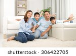 asian family having fun at home | Shutterstock . vector #306422705
