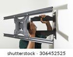 installing mount tv on the wall ... | Shutterstock . vector #306452525