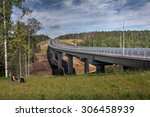 Saint Petersburg, Russia - August 7, 2015: The new steel bridge on concrete pillars crossing bed of forest stream, a modern four-lane highway St. Petersburg - Sortavala, passes through a dense forest. - stock photo