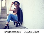 fashion model with long curly... | Shutterstock . vector #306512525