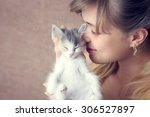 Stock photo beautiful girl hugging a small kitten 306527897