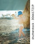 little boy in a diaper outdoors | Shutterstock . vector #306617219