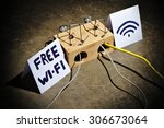 the dangers of free wi fi.... | Shutterstock . vector #306673064