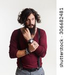 Small photo of Close-up emotional and people concept:young stylish bearded man with good idea sign.Hipster style.wearing watch on his hands,barber shop,bearded man,hipster man,swagger,coat