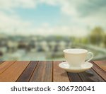 cup of coffee on the balcony...   Shutterstock . vector #306720041