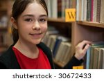young girl in library looking... | Shutterstock . vector #30672433