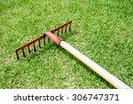 rake lying on grass in the golf ...