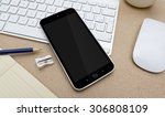 workplace with mobile phone on... | Shutterstock . vector #306808109