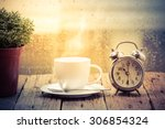 steaming coffee cup on a rainy... | Shutterstock . vector #306854324