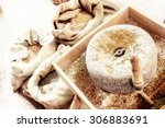 Ancient Millstone With Wheat...