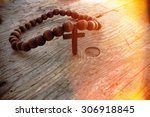 wooden rosary beads and cross... | Shutterstock . vector #306918845