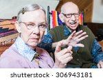 angry old couple sitting in... | Shutterstock . vector #306943181