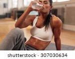fitness woman drinking water... | Shutterstock . vector #307030634