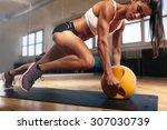Muscular Woman Doing Intense...