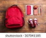 desk with school supplies.... | Shutterstock . vector #307041185