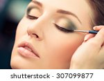 make up artist applying liquid... | Shutterstock . vector #307099877