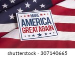 Small photo of resolution american flag with sign Make America great again