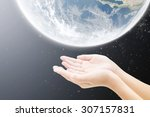 hand and earth      concept...   Shutterstock . vector #307157831