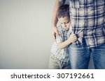 sad son hugging his dad near... | Shutterstock . vector #307192661