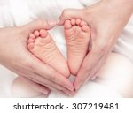 baby's foot in mother hands... | Shutterstock . vector #307219481