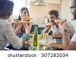 two couples eating pizza in home | Shutterstock . vector #307282034