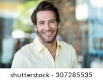 Portrait Of Smiling Man At...