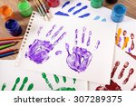 child hand prints on a school... | Shutterstock . vector #307289375