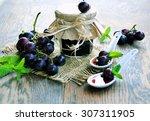 grape jam on a wooden...   Shutterstock . vector #307311905