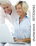 senior couple using computer... | Shutterstock . vector #307326461