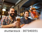 Small photo of people, leisure, friendship and and bachelor party concept - happy male friends drinking beer at bar or pub