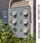 Electric Meters On The Side Of...