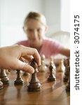 caucasian hand moving chess... | Shutterstock . vector #3074175